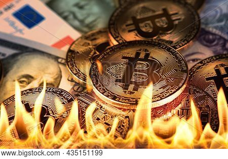 Close Up Heap Of Golden Bitcoin Physical Coins And Paper Money Banknotes Burning In Fire Flames, As