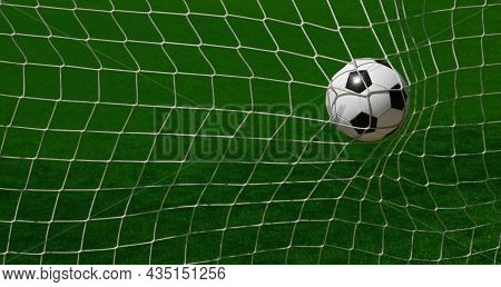 Close Up Black And White Soccer Football Ball Scoring In Goal Net Over Green Turf Of Soccer Field Pi