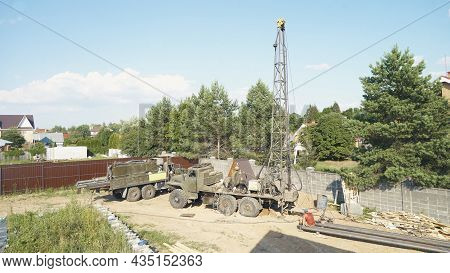 Moscow, Russia - Jule 9 2021: Water Well Drilling Rig, Drill Is Digging A Hole, Holes Boring In Grou