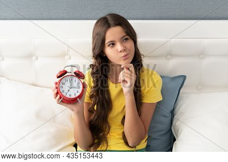You Never Know When Your Time Is Coming. Kid Look Thoughtful With Alarm Clock. Using Time Creatively