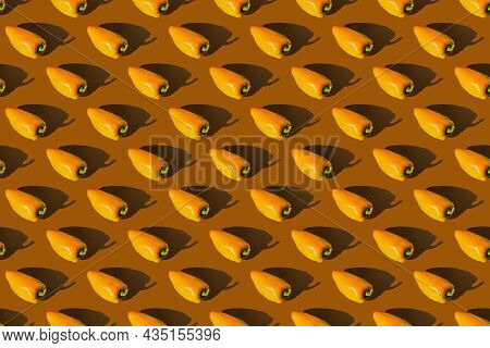 Bell Pepper On A Brown Background. Paprika Seamless Pattern.