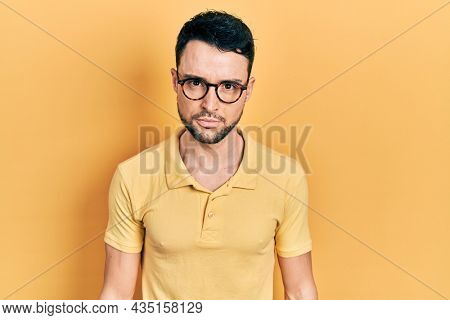 Young hispanic man wearing casual clothes and glasses skeptic and nervous, frowning upset because of problem. negative person.