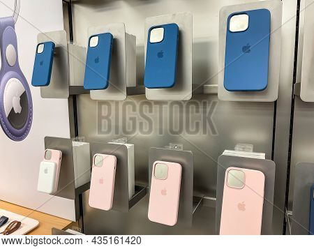 Cologne, Germany - September 30th 2021: A German Photographer Comparing Accessories As Phone Cases F