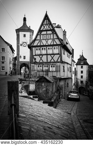 Old street in Rothenburg ob der Tauber, Germany.  Black and white photography