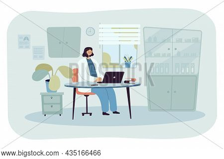 Lady Doctor Sitting At Desk In Medical Office. Physician In Examination Room, Clinic Or Hospital Int