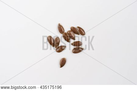Flax Seeds Isolated On White Background. Top View. Macro Shoot Of Dry Flax. Flax Seed Spread Out On