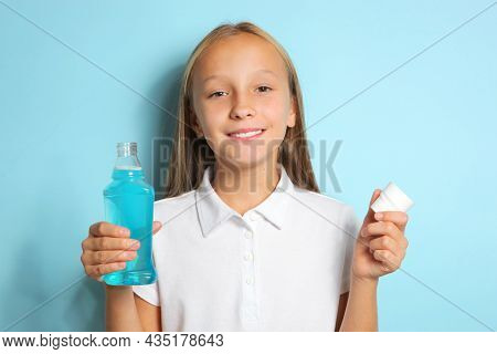 The Child Is Rinsing The Mouth With A Mouthwash. Oral Health In Children