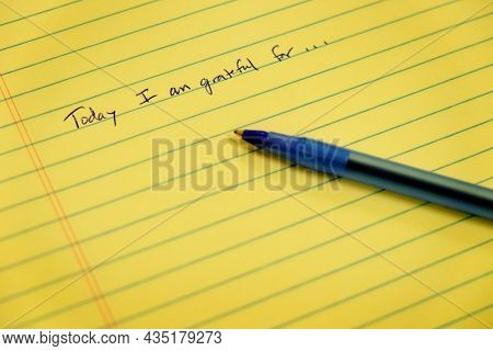 Gratitude notebook with pen writing today I am grateful for