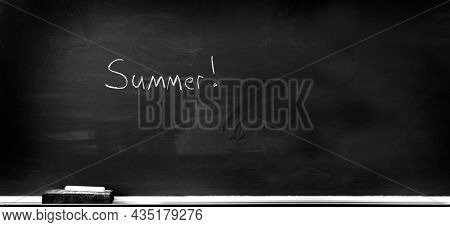 Chalkboard in school for education with eraser and chalk writing summer vacation summertime