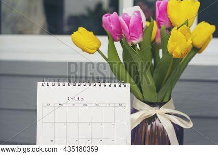 Calendar Desk And Tulip Flower On Table. Desktop Calender For Planner To Plan Wedding Agenda, Timeta