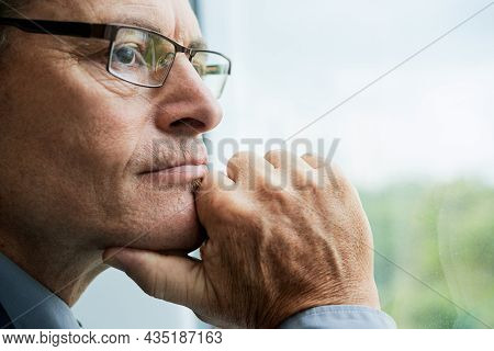 Headshot Of Thoughtful Mature Caucasian Man In Glasses Touching Chin And Contemplating Cityscape Thr