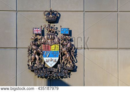 Calgary, Alberta, Canada - 1 October 2021: Arms Of Canada On The Wall Of A Building
