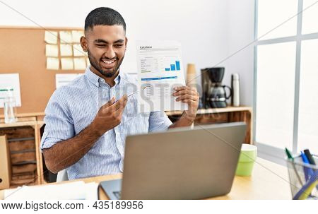 Young arab man smiling confident having video call at office