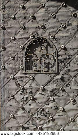 Old Forged Metal Door In Santa Maria Magdalena Sanctuary In Novelda, Alicante, Spain.