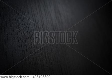 Abstract Dark Black Background With A Wood Texture Pattern Close-up With Selective Focus. Soft Focus
