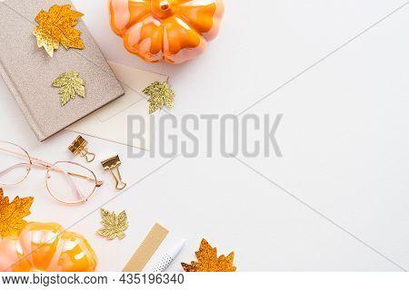 Autumn Desk Table With Maple Leaves, Pumpkins, Paper Notebook, Glasses. Cozy Feminine Workspace. Fla