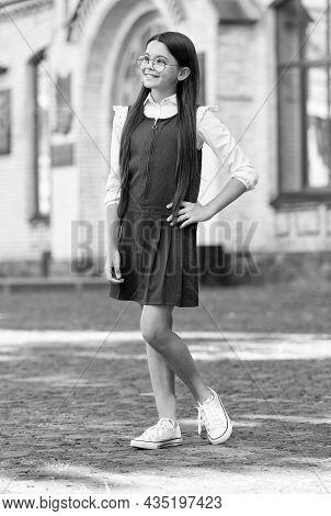 My Uniform As Functional As Fashionable. Happy Kid Wear Uniform In Schoolyard Outdoors. Schoolwear T