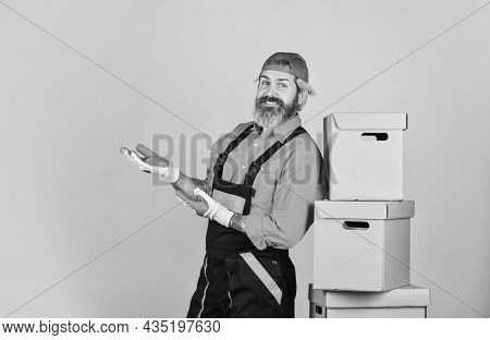 Successful Engineer. Move To New Apartment. Bearded Loader In Uniform. Cardboard Boxes. Moving To Ne