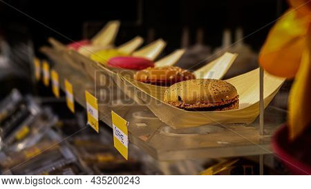 Colorful Macarons Cakes. Small French Cakes. Sweet And Colorful French Macaroons Falling Or Flying I