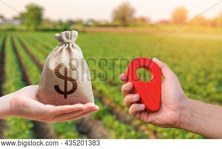 Hands With Location Pin And Money Bag. Buying And Selling Land. Land Market. Estimation Cost Of Plot