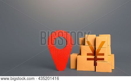 Cardboard Boxes With Chinese Yuan Or Japanese Yen And Red Pin Location Tracking Symbol. Import Expor