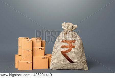 Boxes And Indian Rupee Money Bag. The Concept Of Trade In Goods And Production. Profit From Trading.