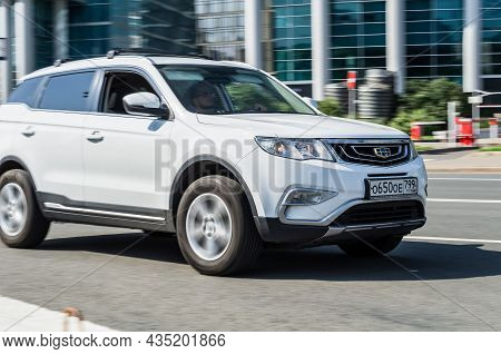 White Geely Boyue Geely Atlas Car In Motion On Urban Road. Geely Atlas Is A Compact Crossover Suv Of
