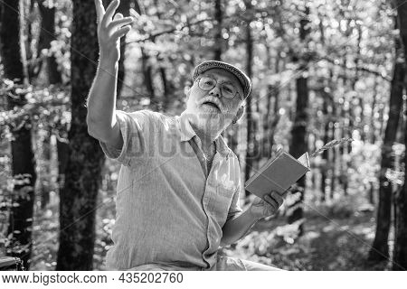 Reading Book. Hobby And Leisure. Grandfather In Nature. United With Nature. Weekend In Nature. Vacat