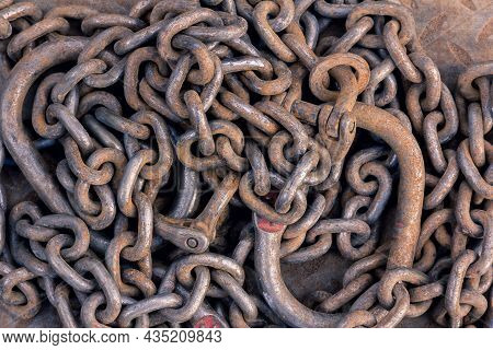 Construction Chain. Rusty Chains Background. Chain Used For Lifting Loads On A Construction Site