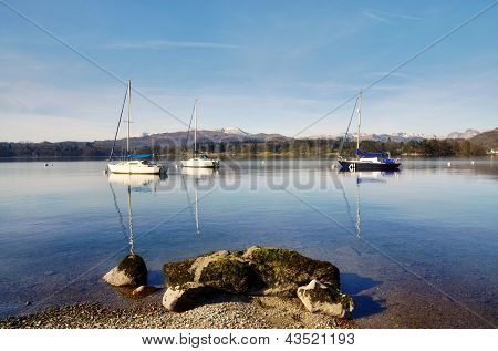 Lake Windermere with three boats and a rock