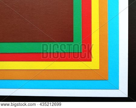 Multicolored Banner With Bright Stripes Of The Spectrum, Sheets Of Colored Cardboard Folded With Con
