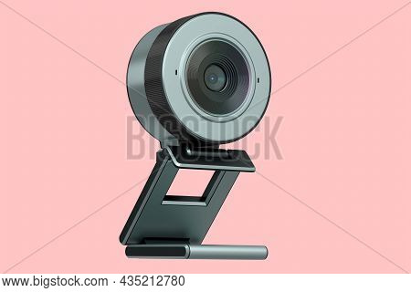 Web Camera On Stand For Online Video Chat And Conference On Pink Background