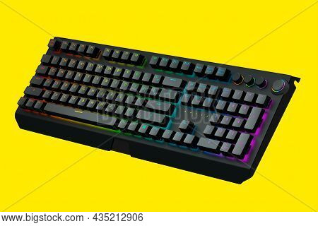 Black Computer Keyboard With Rgb Colors Isolated On Yellow Background.