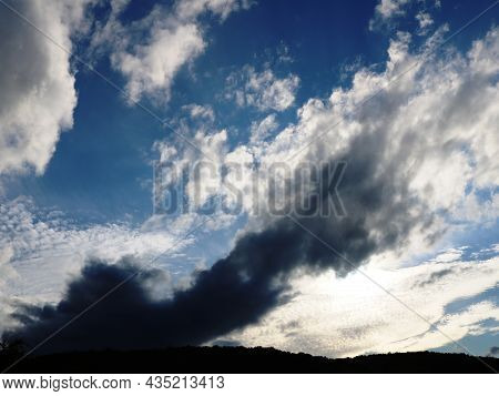 Heavenly Heights With Thunderclouds And Light Laciness At Different Heights, A Beautiful Sky With A