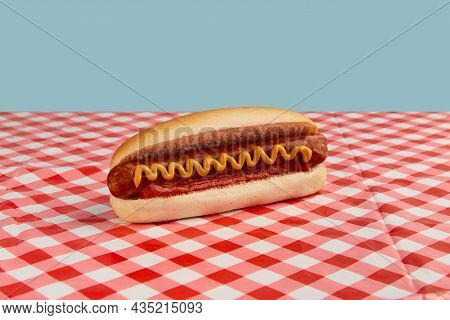 Classic Hot Dog With Wurst, Ketchup And Mustard On The Picnic Table. Menu For Restaurant