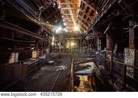 Old Rusty Abandoned Metallurgical Plant. Ruined Blast Furnace