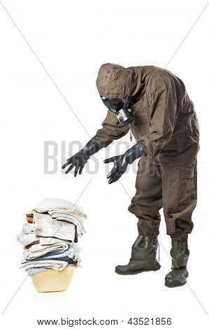 Man In Hazard Suit Looking At Dirty Laundry