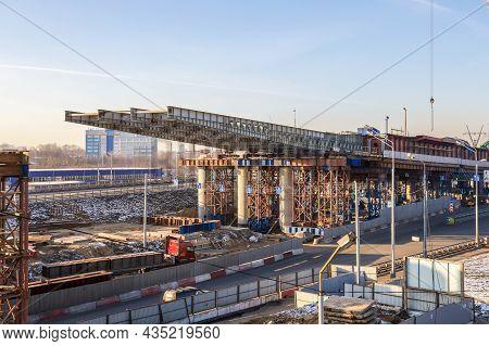 Construction Of An Automobile Overpass Using The Sliding Method. Sliding A Steel Bridge Onto Concret