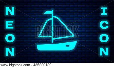 Glowing Neon Yacht Sailboat Or Sailing Ship Icon Isolated On Brick Wall Background. Sail Boat Marine