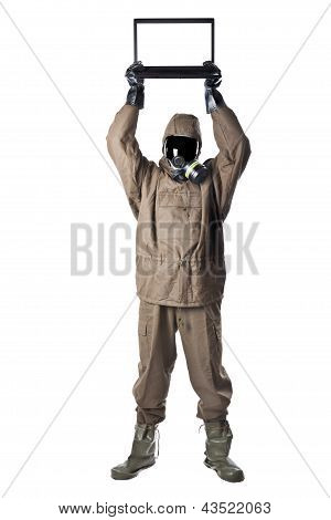 Man In Hazard Suit Holding A Laptop Over His Head
