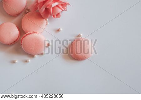Pink French Macaroons On White Background. Sweet Background. Copy Space Vintage Tone