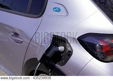 Bordeaux , Aquitaine  France - 09 30 2021 : Peugeot 208 Charging Ev E-208 Electric Car Vehicle Produ