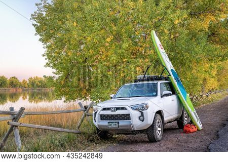 Fort Collins, CO, USA - October 4, 2021:: Toyota 4Runner SUV (2016 trail model) with an inflatable touring stand up paddleboard by Red after paddling in one of Fort Collins natural areas.