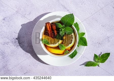 Black And Green Tea With Lemon, Cinnamon Sticks And Mint Leaves. Hot Drink. Healthy Melissa Tea Natu