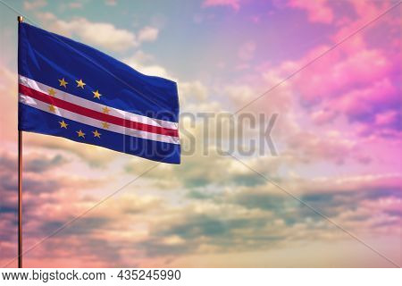 Fluttering Cabo Verde Flag Mockup With The Place For Your Text On Colorful Cloudy Sky Background.