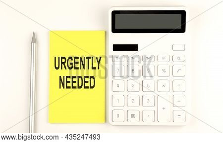 Text Urgently Needed On The Yellow Sticker, Next To Pen And Calculator