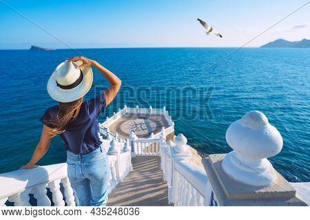 Carefree Young Tourist Woman In Sun Hat Enjoying Sea View At Balcon Del Mediterraneo In Benidorm, Sp