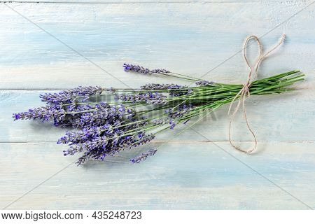 Lavender Bouquet On A Rustic Wooden Background, A Bunch Of Lavandula Plants, Aromatic Herb