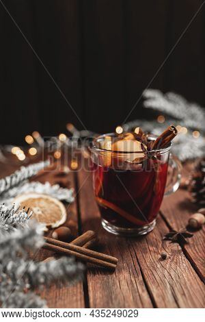 Christmas Time Concept Photo. Glass Cup Or Mug With Mulled Wine Inside On Wooden Table And Backgroun