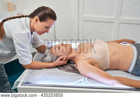 Young Professional Osteopath Checking Work Of Muscles